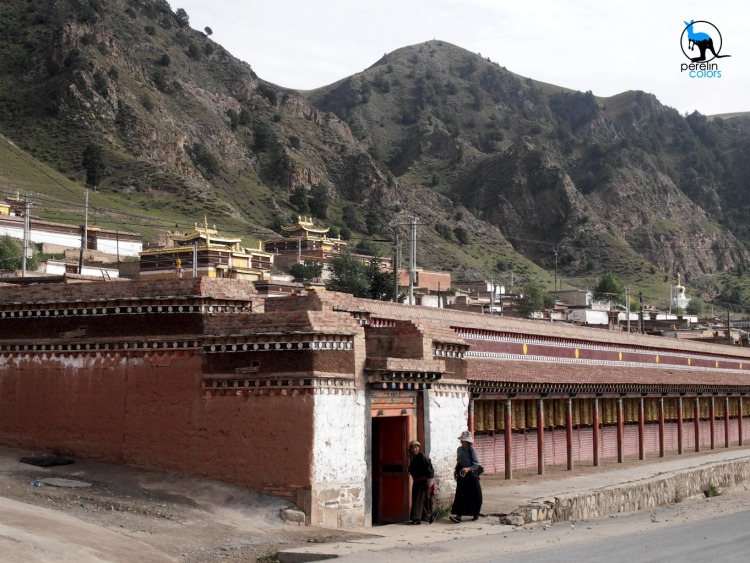 Labrang monastery in the morning with two Tibetans walking the khora.