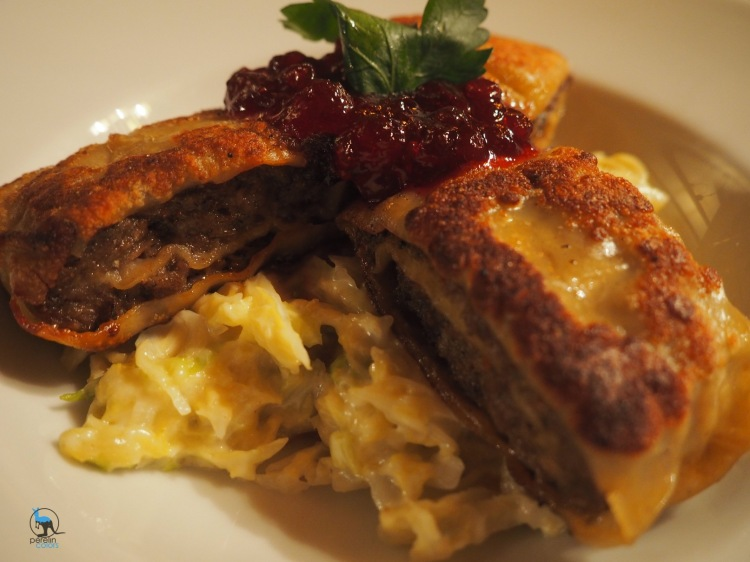 Fried Maultaschen filled with venison, served with creamy savoy cabbage and cranberries.